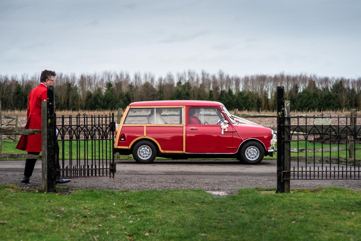 Wedding car photoraph. Mini clubman arrives at church
