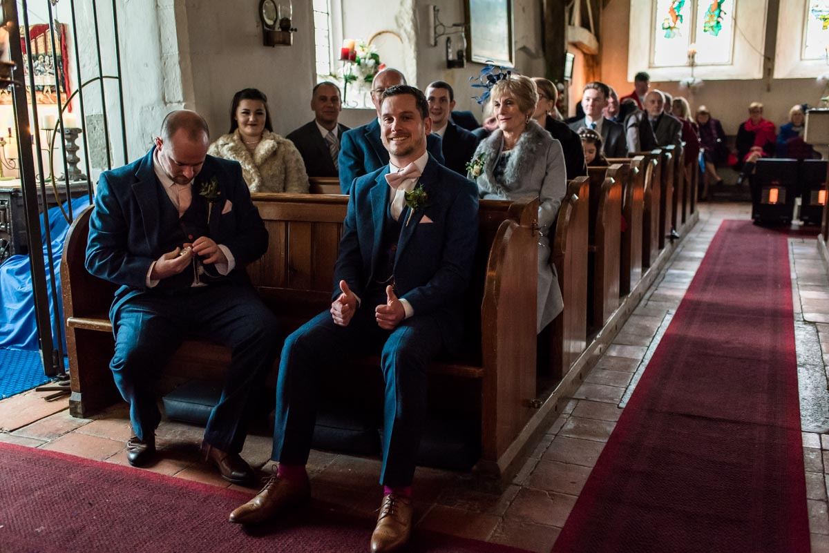 The groom is photographed giving the thumbs up before his Kent wedding ceremony