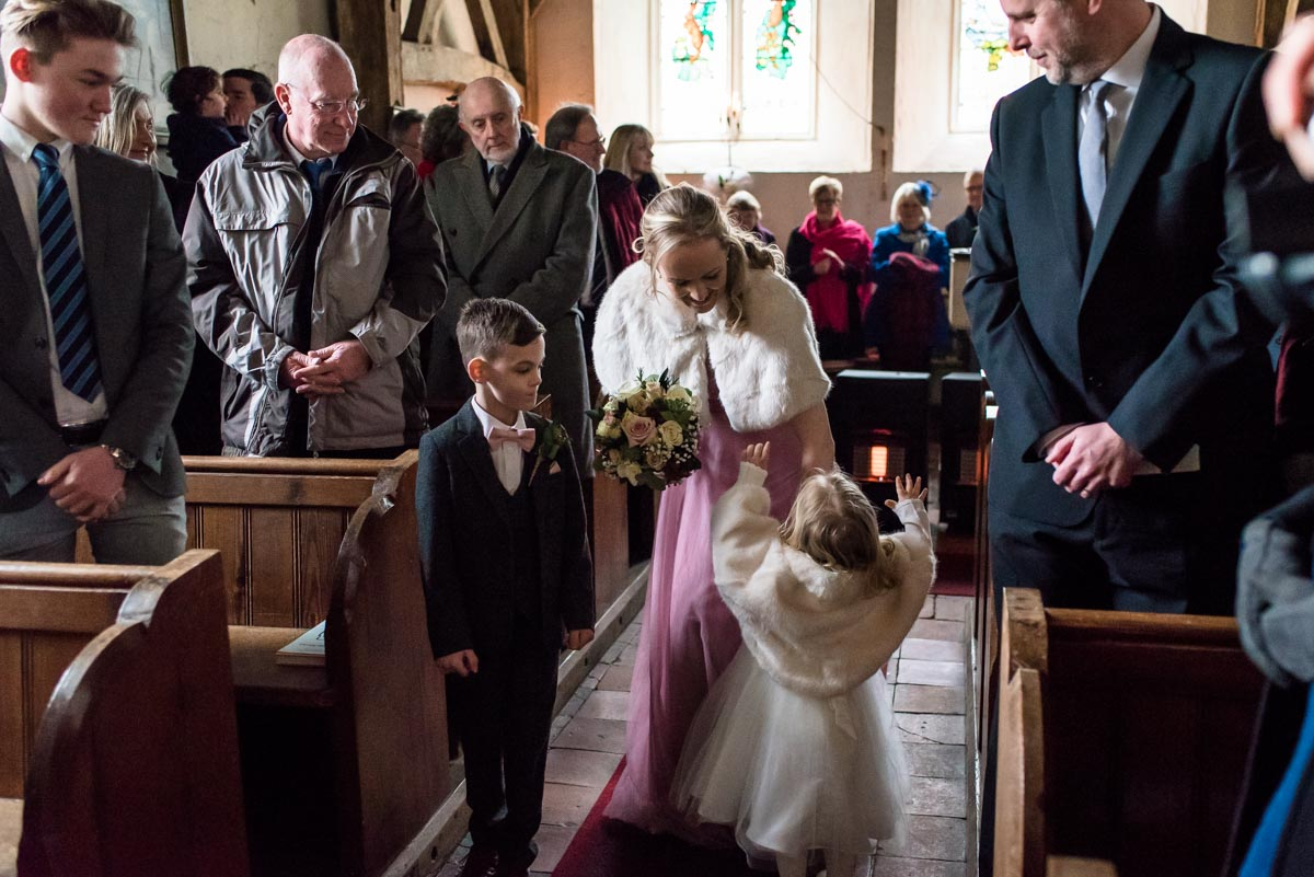 Photograph of Rebeccas bridesmaid, flower girl and page boy in Kent church on her wedding day