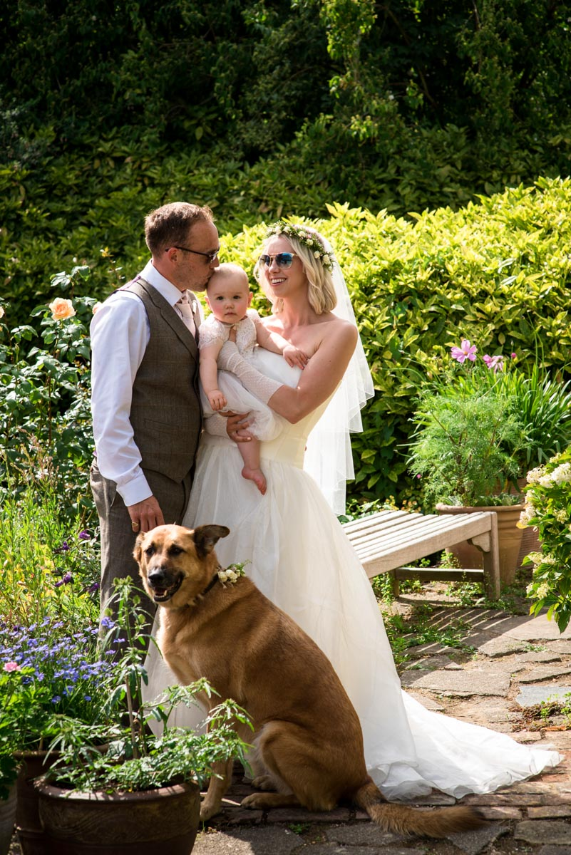 Photograph of Ann and Josh with their baby and dog on their wedding day