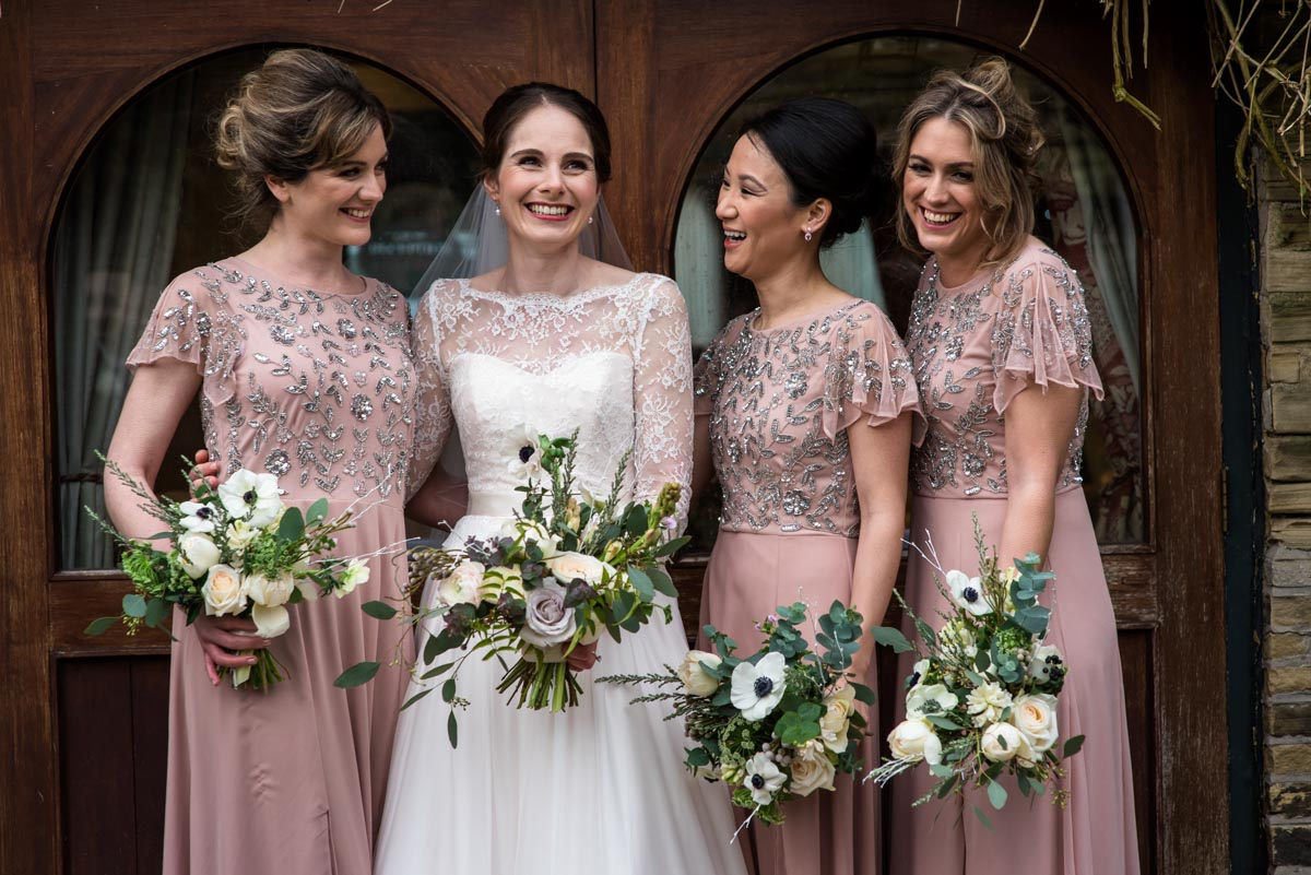 Katherine and her bridesmaids photographed together on her winter wedding day