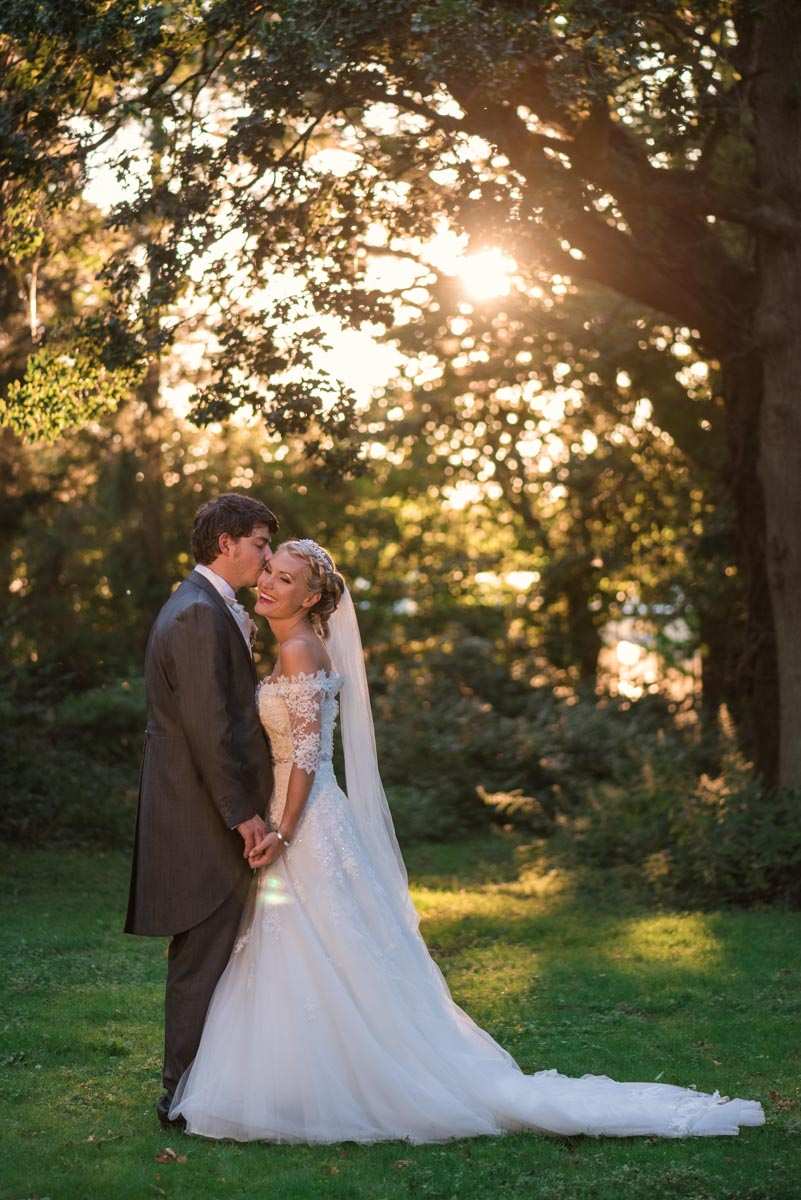 Photoraph of couple photographed on their wedding day during the golden hour