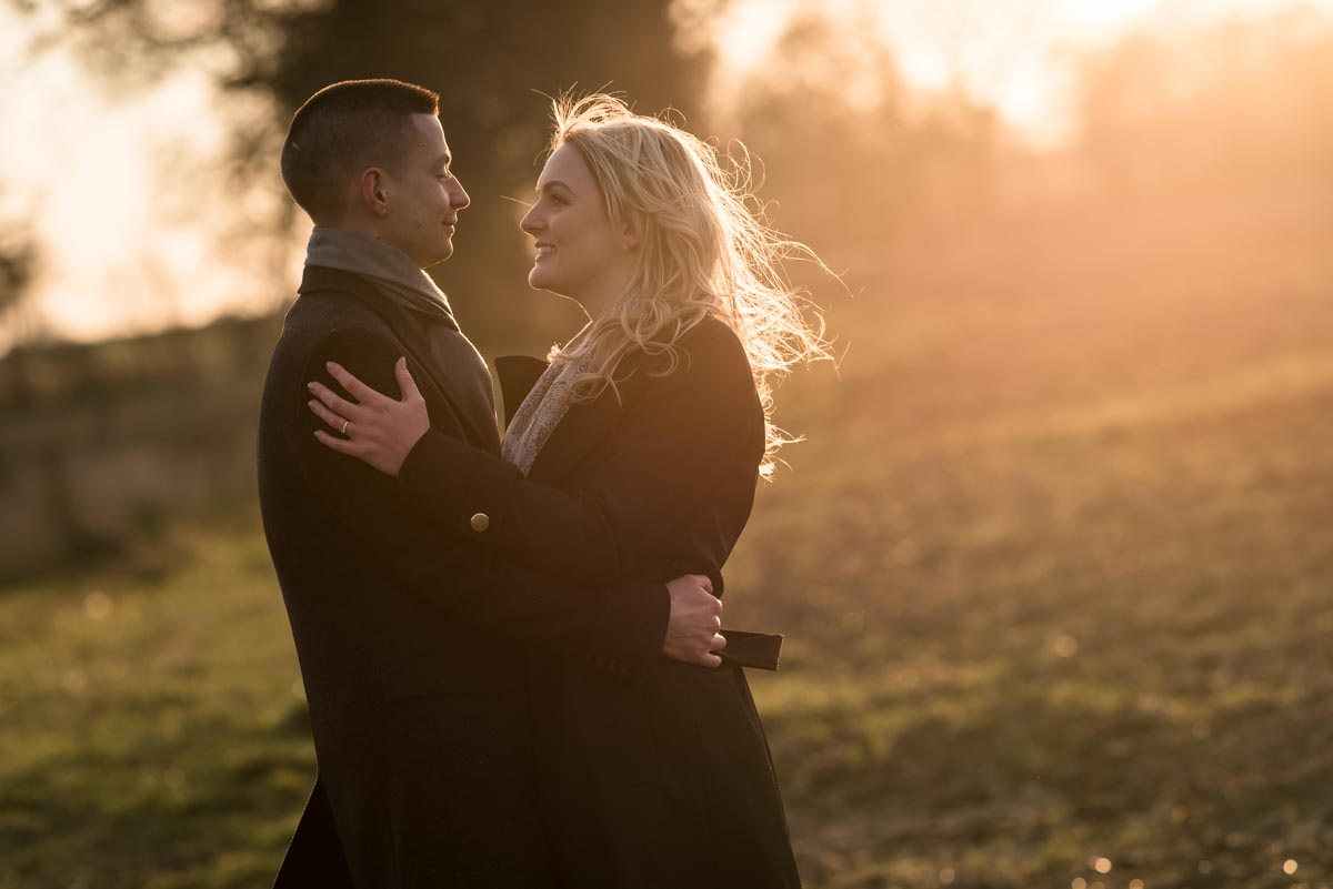 Engagement photography during the golden hour of winter sun on the farm in Kent