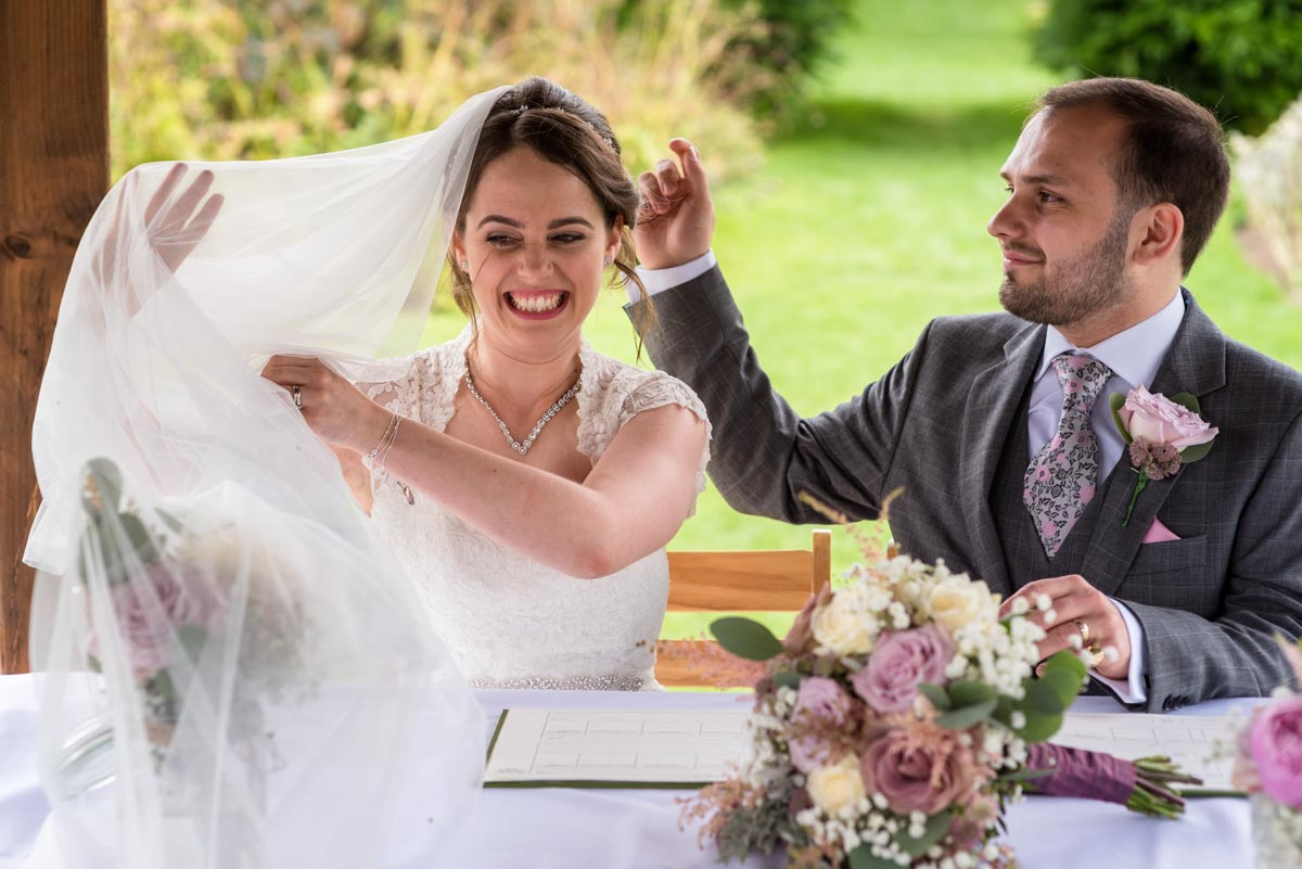 Brides veil blows away during signing of the register