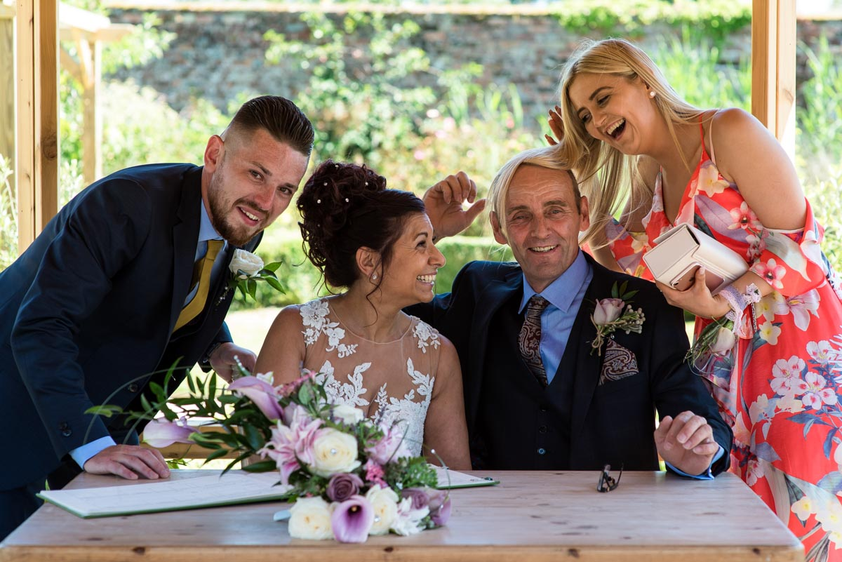 Signing the register, Secret garden wedding, Kent