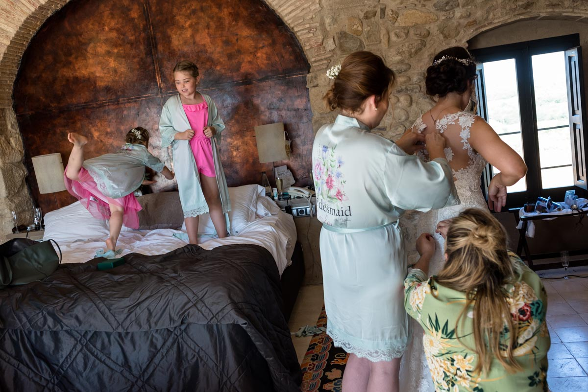 flower girls enjoy getting ready before Rebecca and Matts wedding at castell d'emporda in Spain