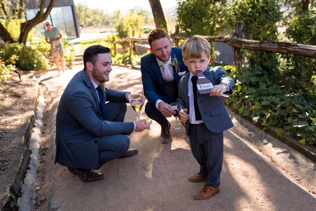 matt and page boy have fun at his wedding at castell d'emporda in Spain