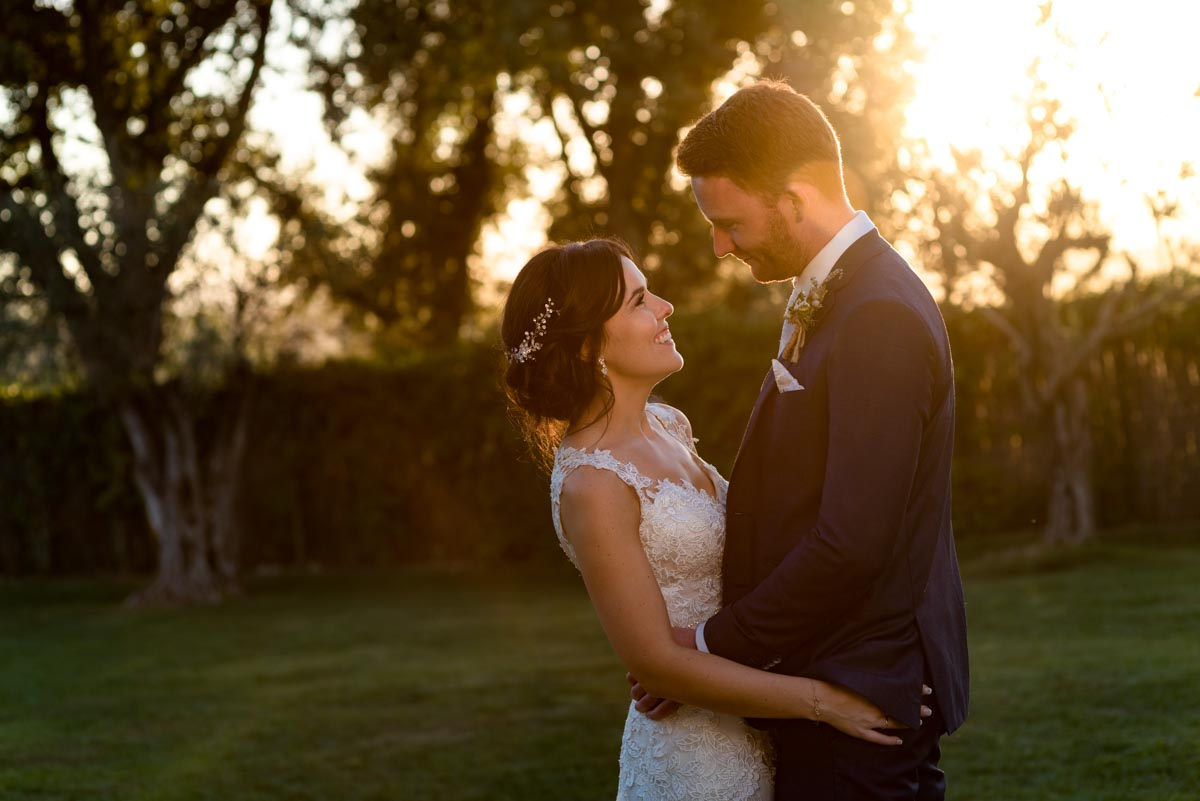 sun set photograph of matt and rebecca at their wedding at castell d'emporda