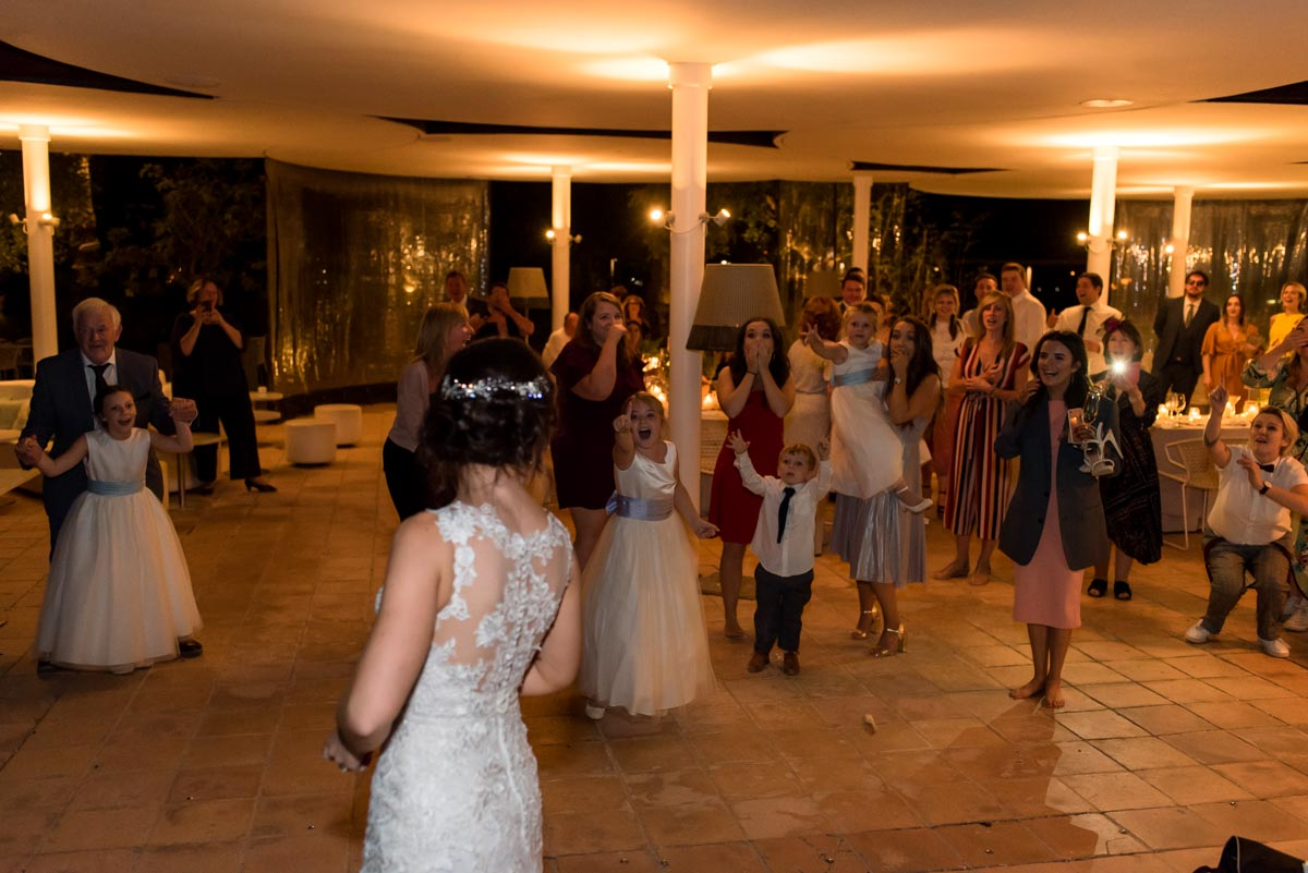 photograph of wedding guests after bouquet throw