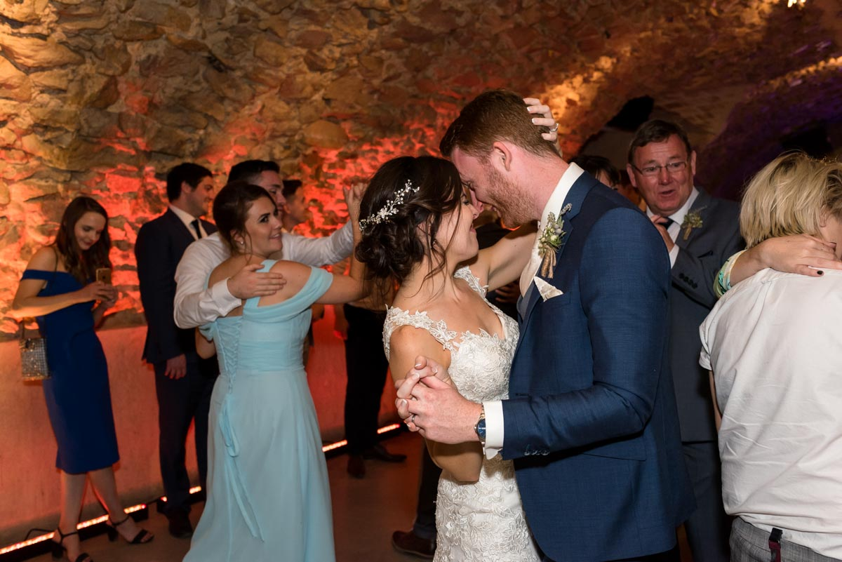 matt and rebecca photographed doing their first dance in the cave at castell d'emporda