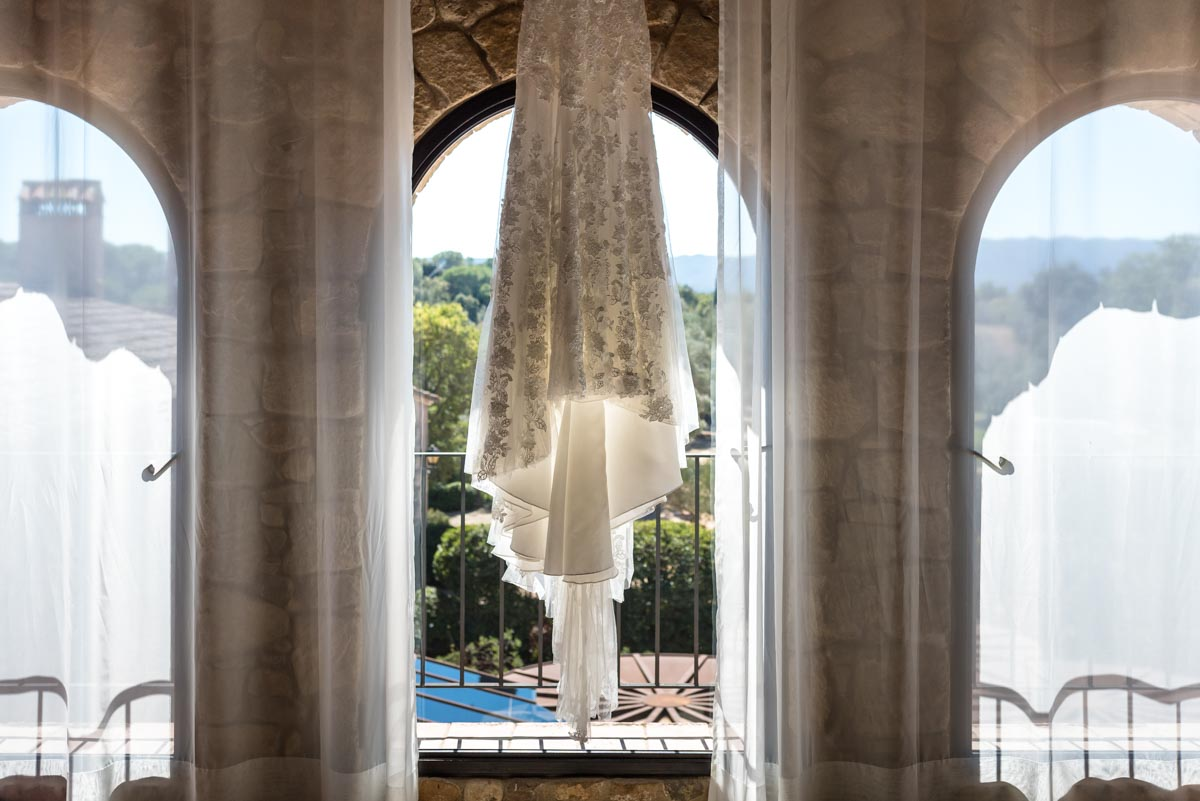 Rebeccas wedding dress photographed hanging in the bridal suite as castell d'emporda