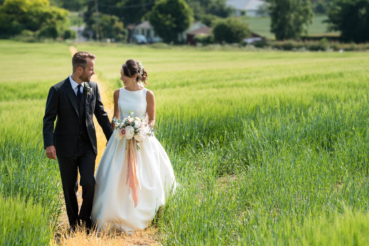 Sarah & Craig take a walk on their wedding day at Odo's Barn in Kent