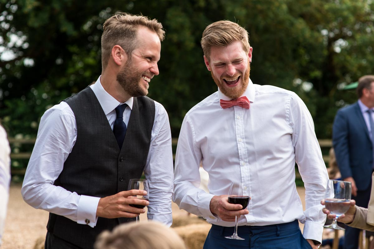 Odo's Barn wedding photography, Craig laughs with friends