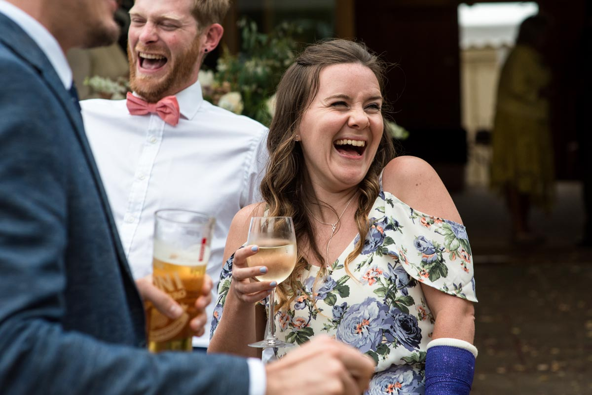 odo's Barn wedding photography, guests laughing during drinks reception