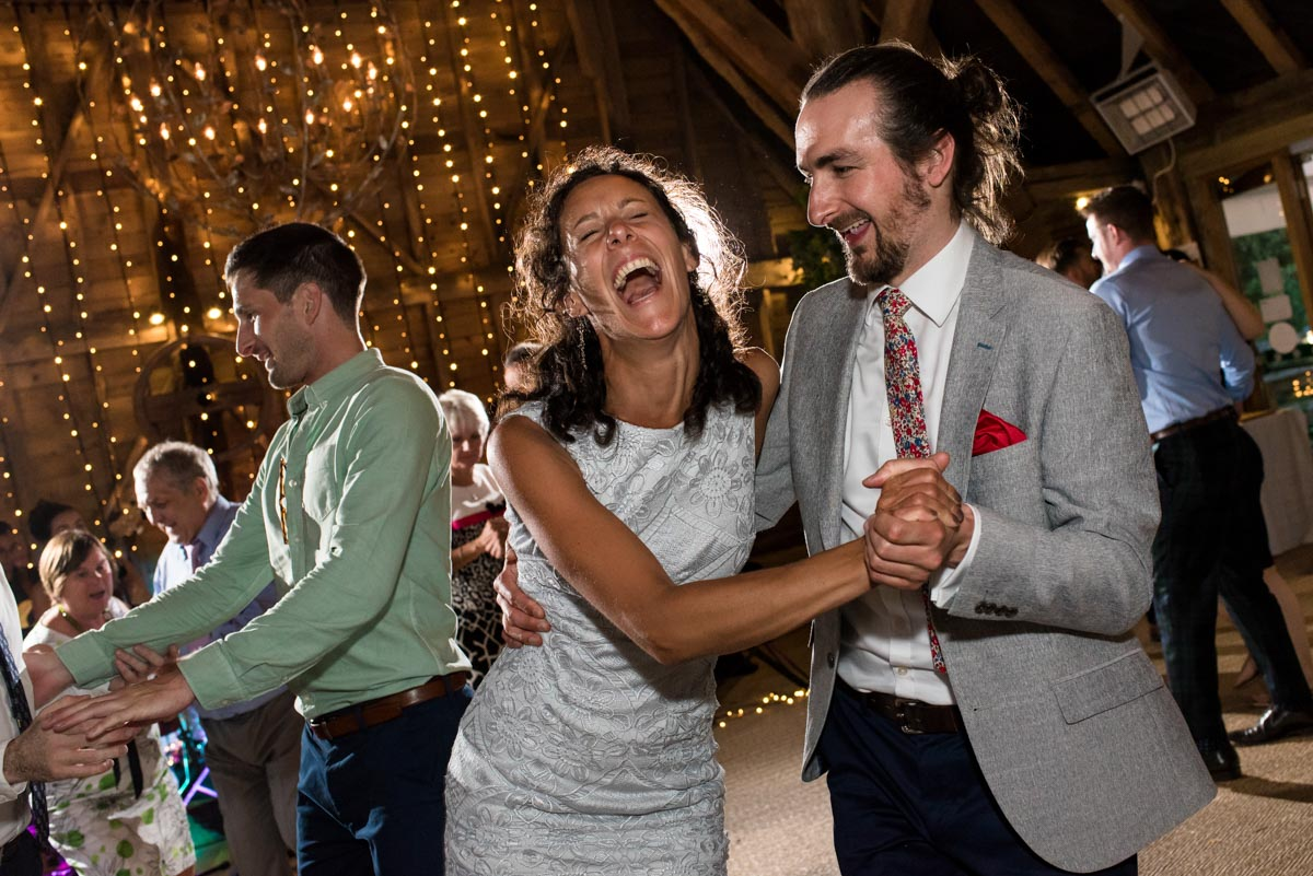 odo's Barn wedding photography, guests enjoy the dancing