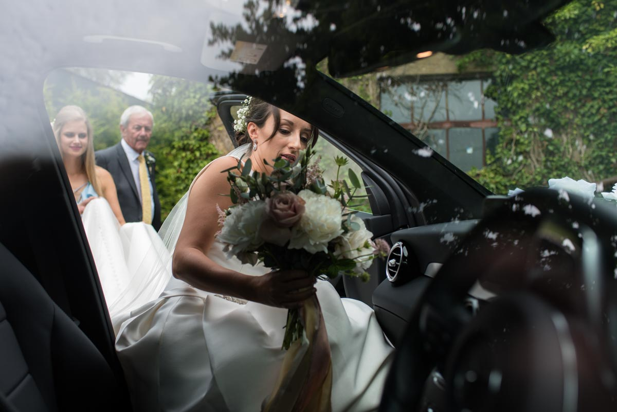 Sarah gets in the car to take her to Odo's Barn in Kent for her wedding