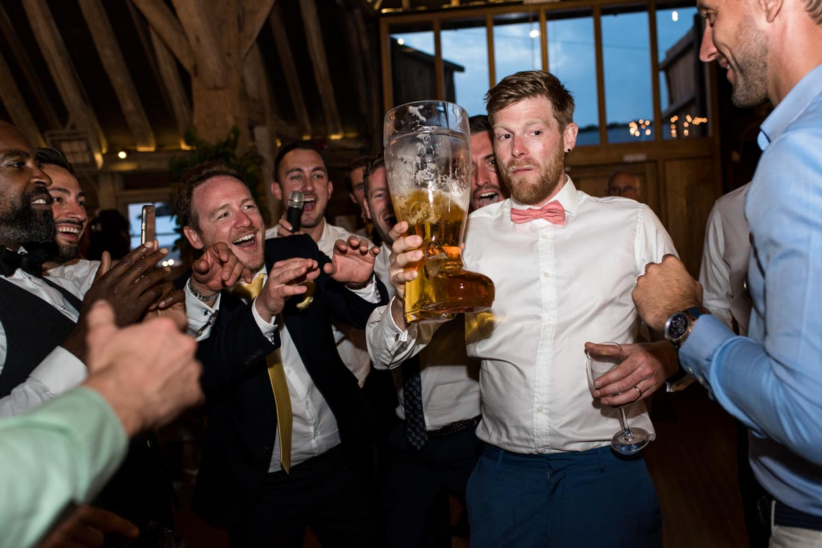 Passing the beer boot at Sarah and Craigs wedding reception at Odo's Barn in Kent