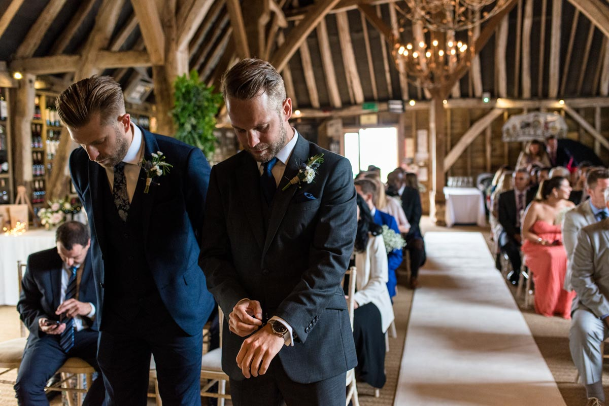 Craig waits for his bride before his Odo's Barn wedding ceremony in Kent
