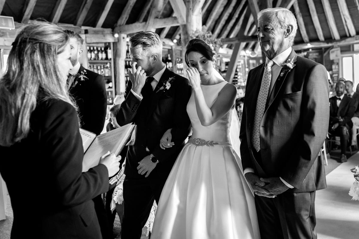 Sarah and Craig shed a tear during their wedding ceremony at Odo's Barn in Kent