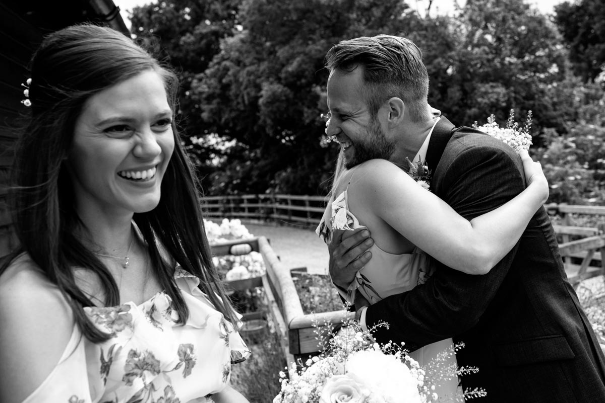 Craig is congratulated by bridesmaids at his wedding at Odo's Barn in Kent