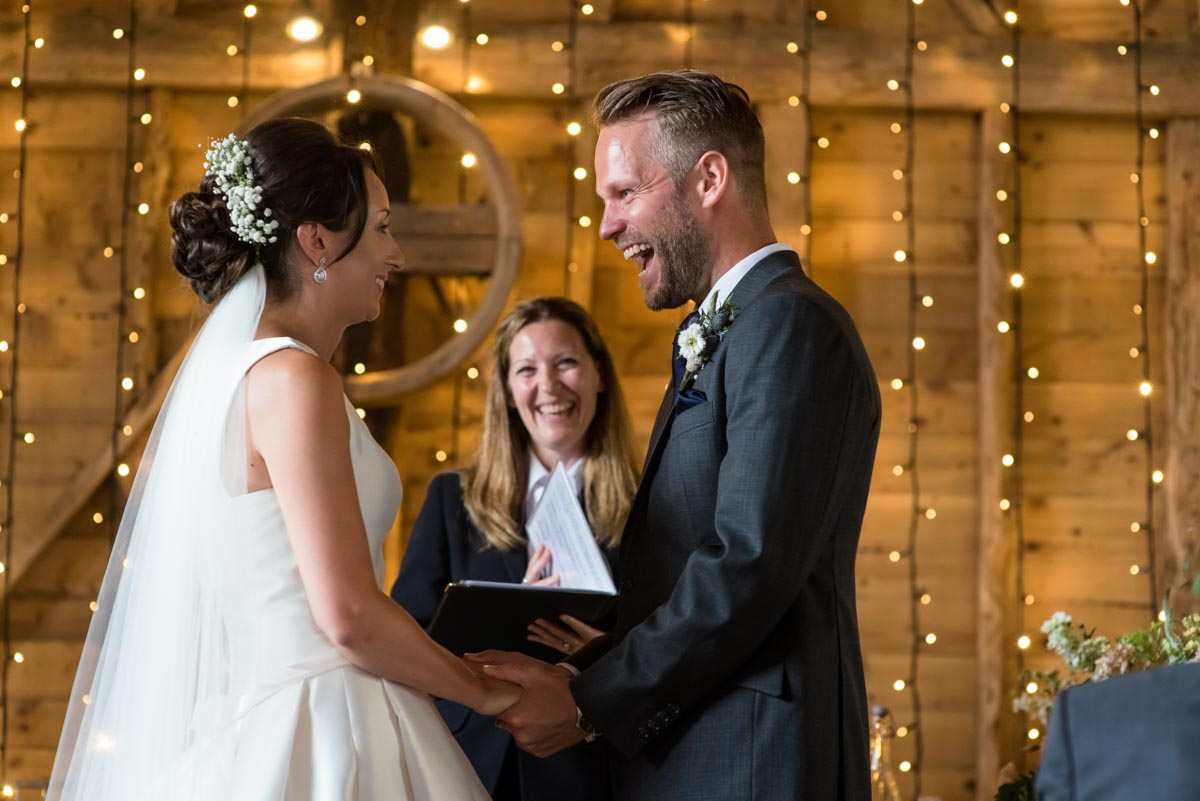 happy moment between Sarah and Craig during their wedding at Odo's Barn wedding in Kent
