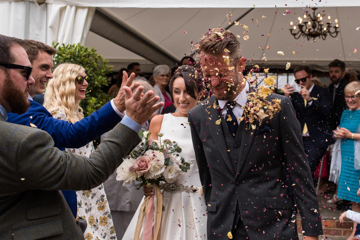 Odo's Barn wedding photography,Craig and Sarah have confetti thrown in their faces