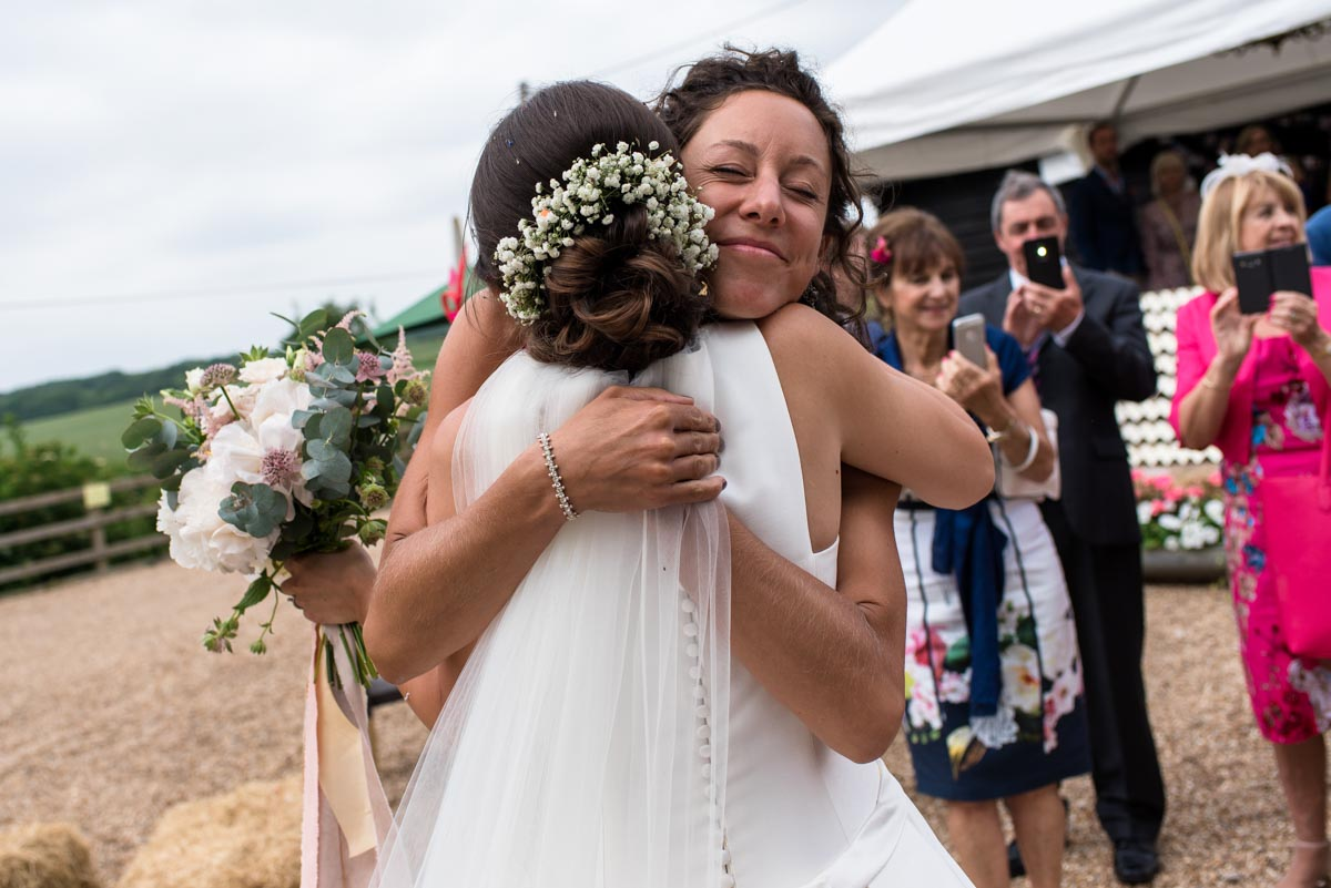 Hugs from friends, odo's Barn wedding photography in Kent