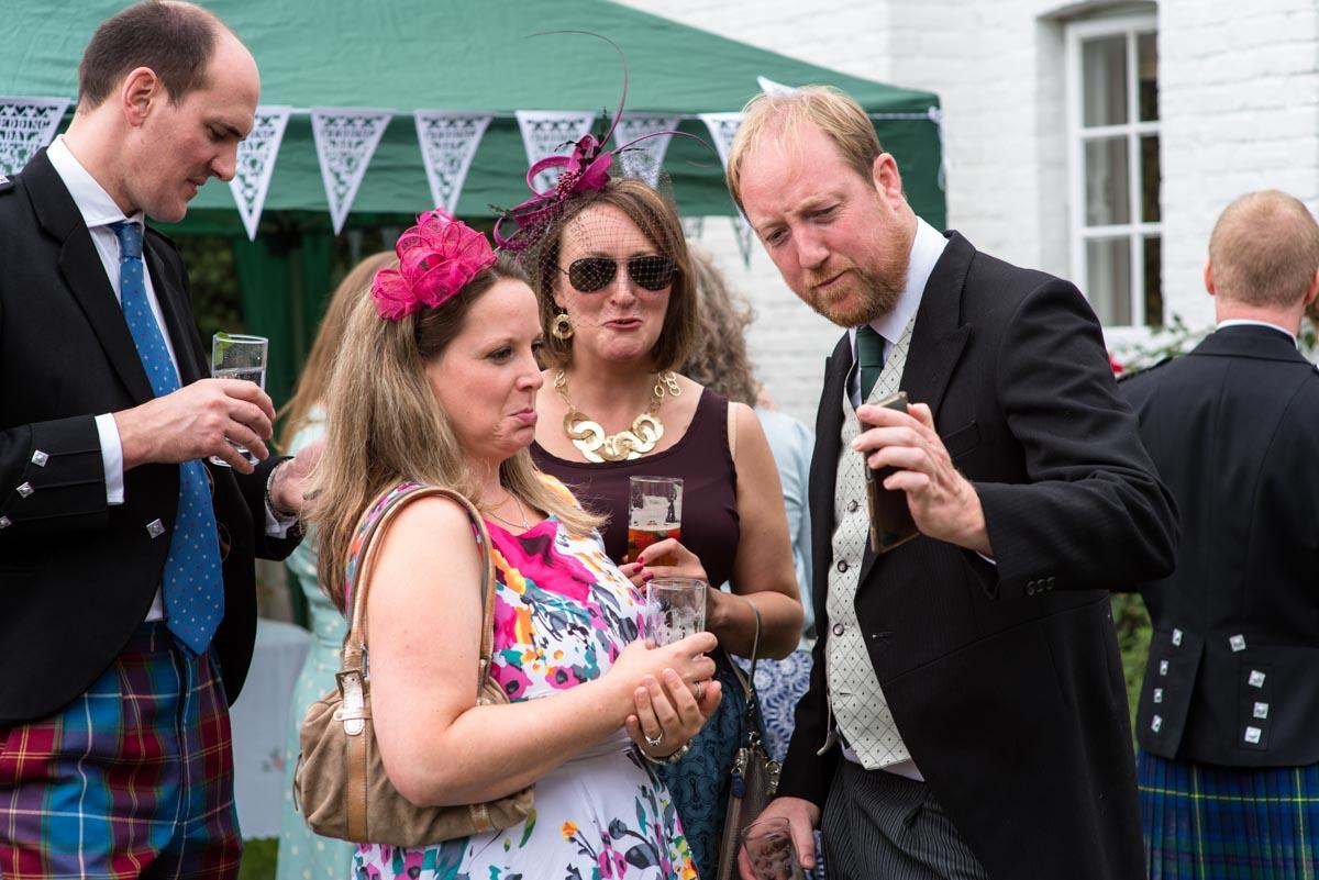 Canterbury wedding Photography, guests enjoying drinks at hannah and Matthews wedding