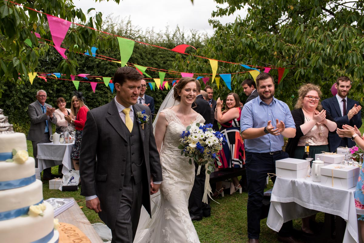 Hannah and Matthew arrive to their orchard wedding reception in kent