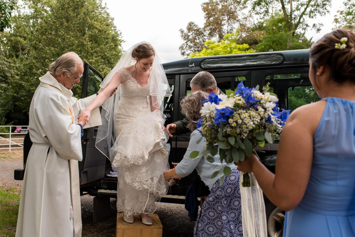 hannah helped out of wedding transport