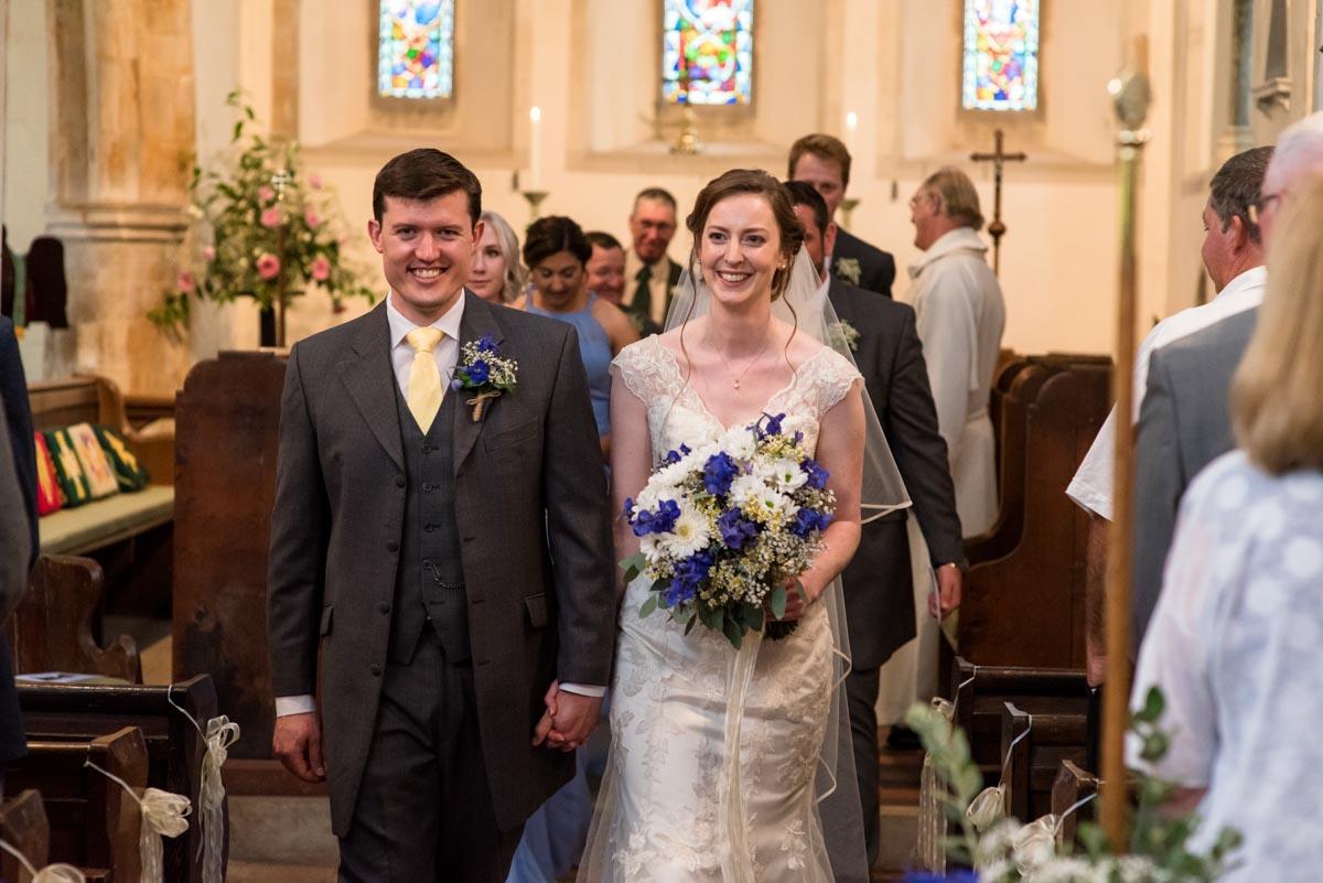 Hannah and Mathew leave church after their Kent church wedding