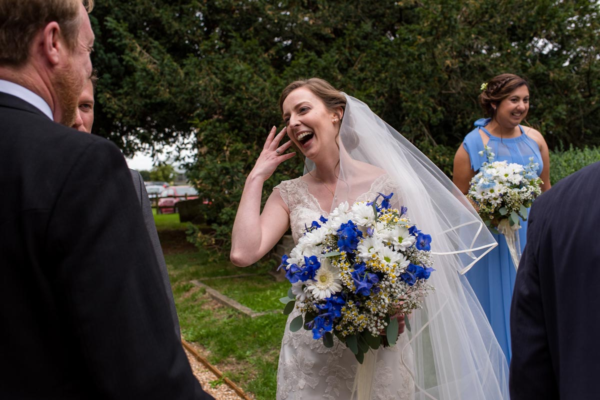 Canterbury wedding photography, greeting guests after the ceremony