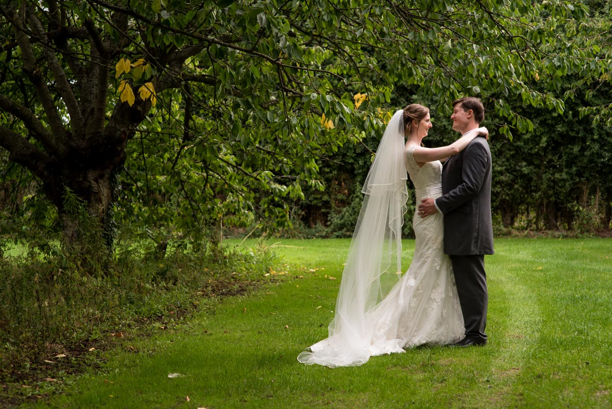 Canterbury wedding Photography - photograph of hannah and Matthew on their wedding day in the orchard