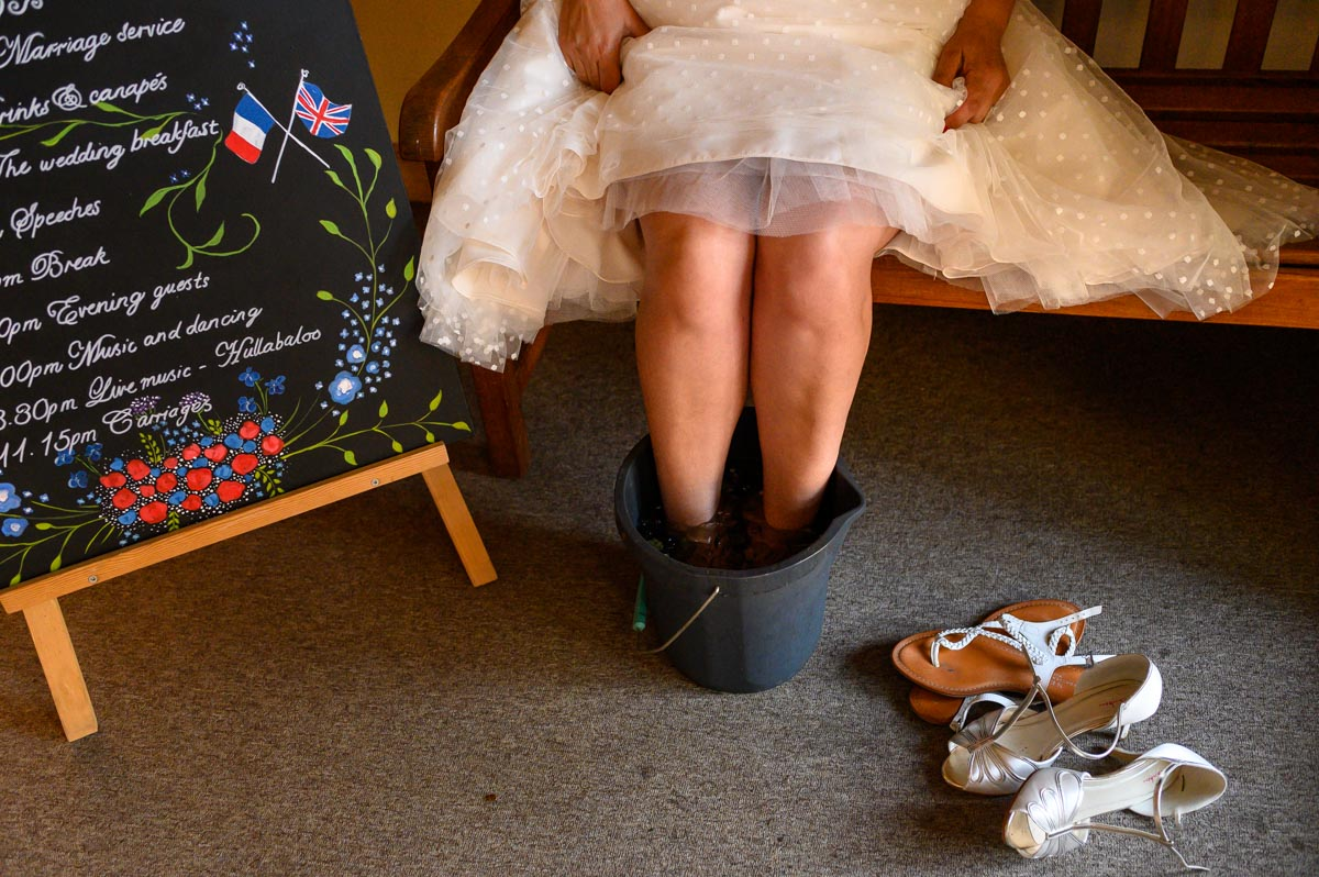 Nathalie soaks her tired feeet after her Kent Church wedding in Egerton