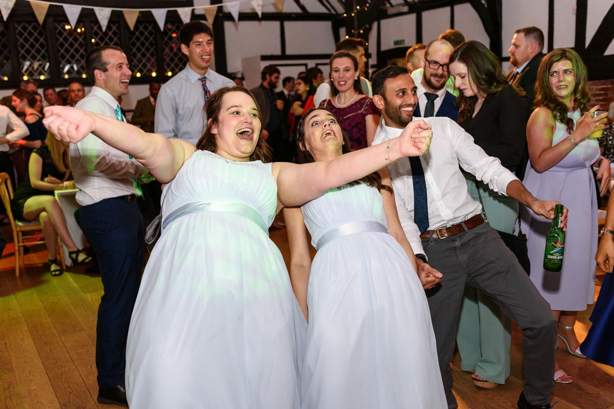 Guest dancing at Ed and Stephanies Chilham Village Hall wedding in Kent