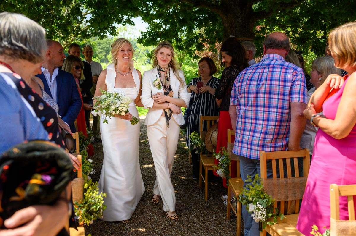 Mariette's walked down the aisle by her daughter at Ratsbury Barn summer wedding