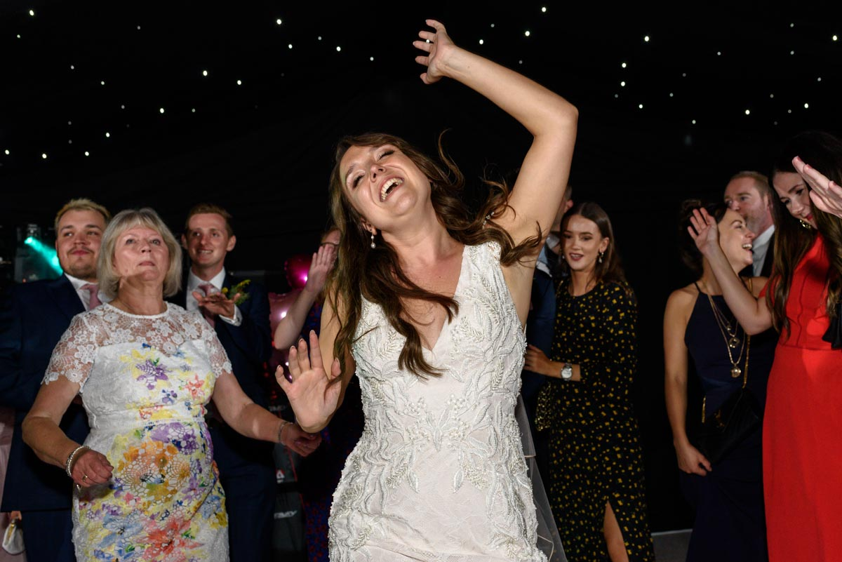 Kailey enjoys the dancing at her Ferry House Inn wedding reception