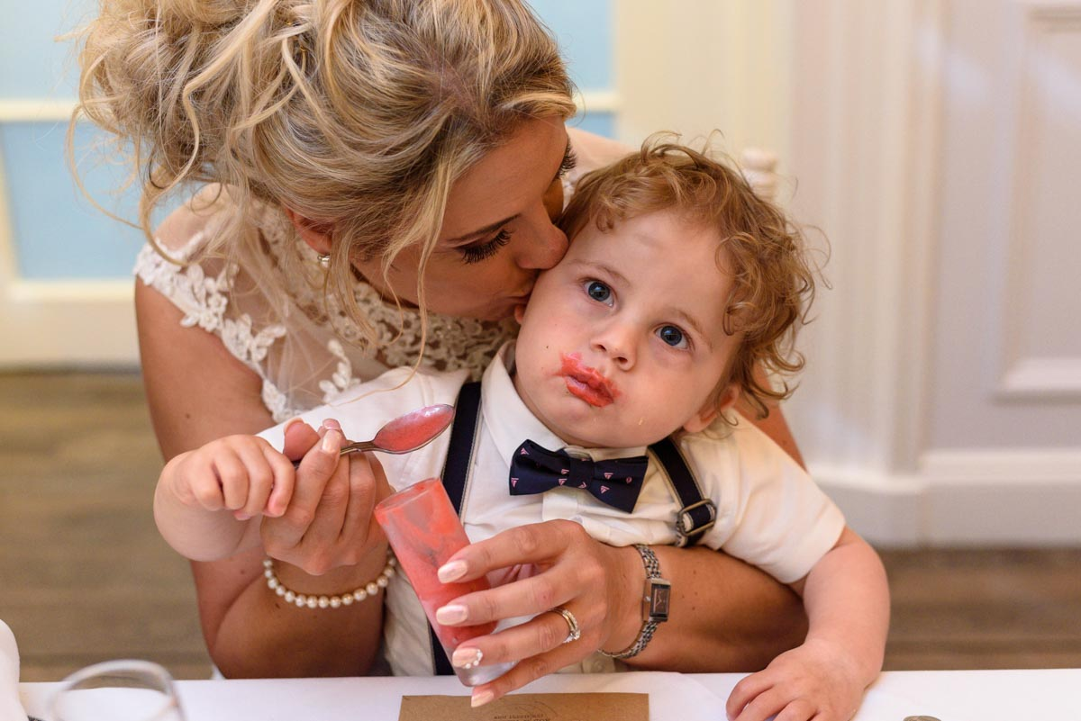 Keeley and her son enjoy wedding food at The Hythe Imperial