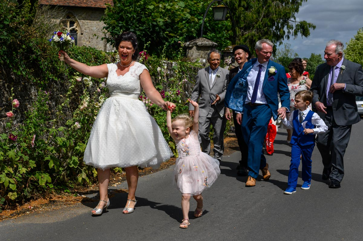 Bridal party rejoice after Egerton Church wedding