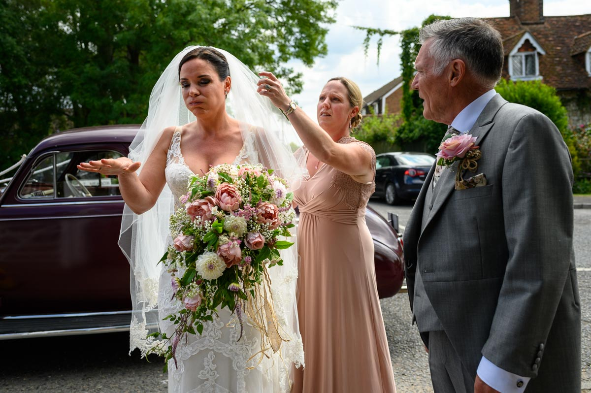 Bridal nerves show before Emma marries Chris in Smarden Church