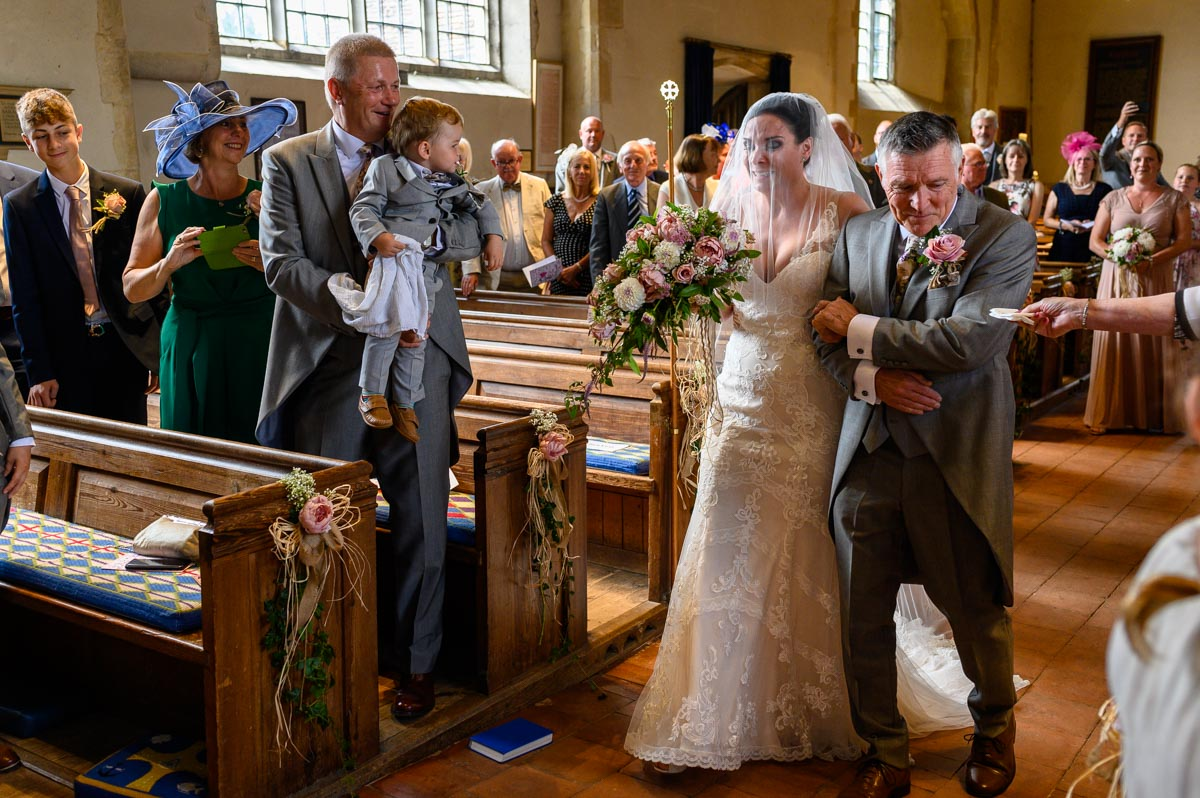 Emma sheds tears coming down the aisle during her Kent church wedding