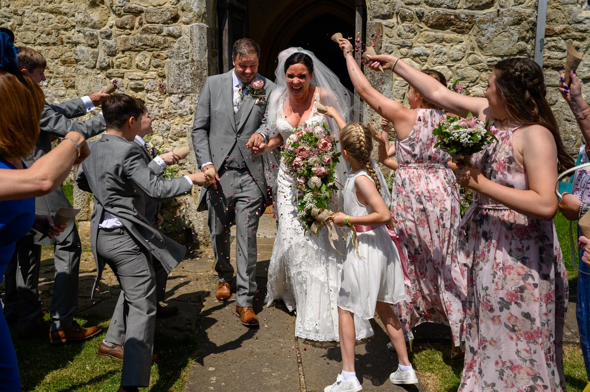 Emma & Chris run through confetti at their Smarden Church wedding in Kent