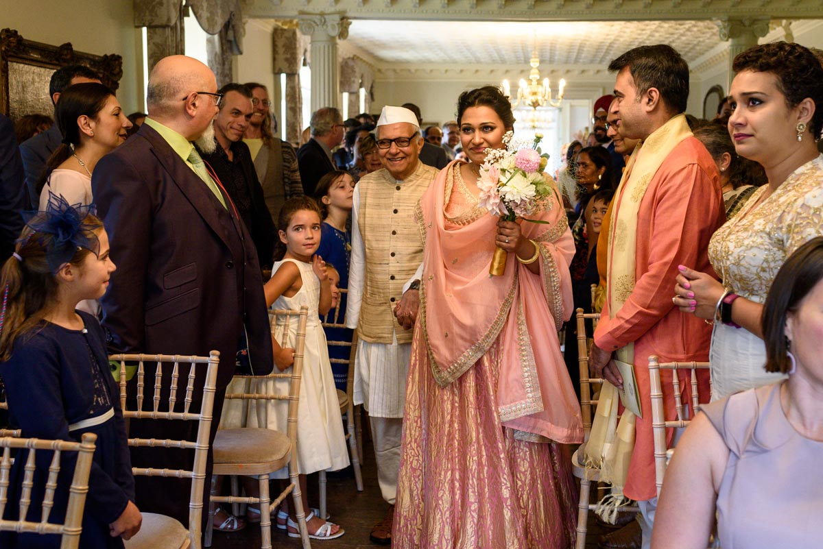Vinita walked down the aisle by her father at her Chilston park wedding