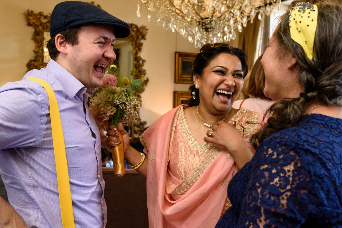 Vinita shares a laugh with wedding guests during her Chilston park wedding reception