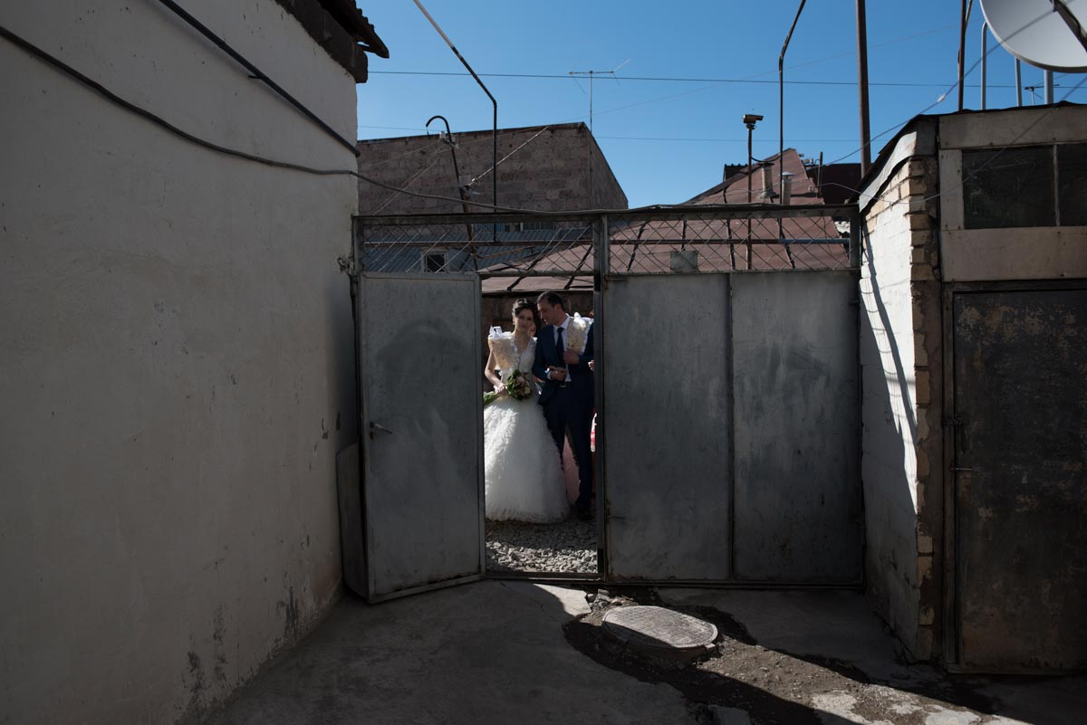 Photograph of Armenian wedding couple about to enter house