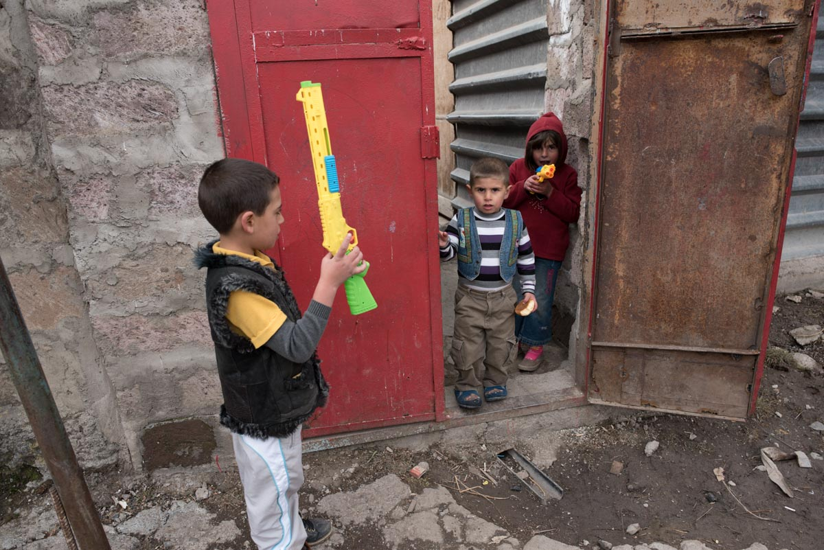 Boys playing with toy guns in Gyumri, Armenia