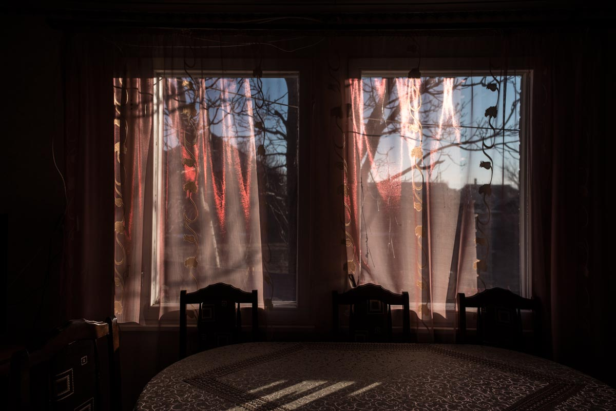 Afternoon light shining through pink curtains in Gyumri, Armenia