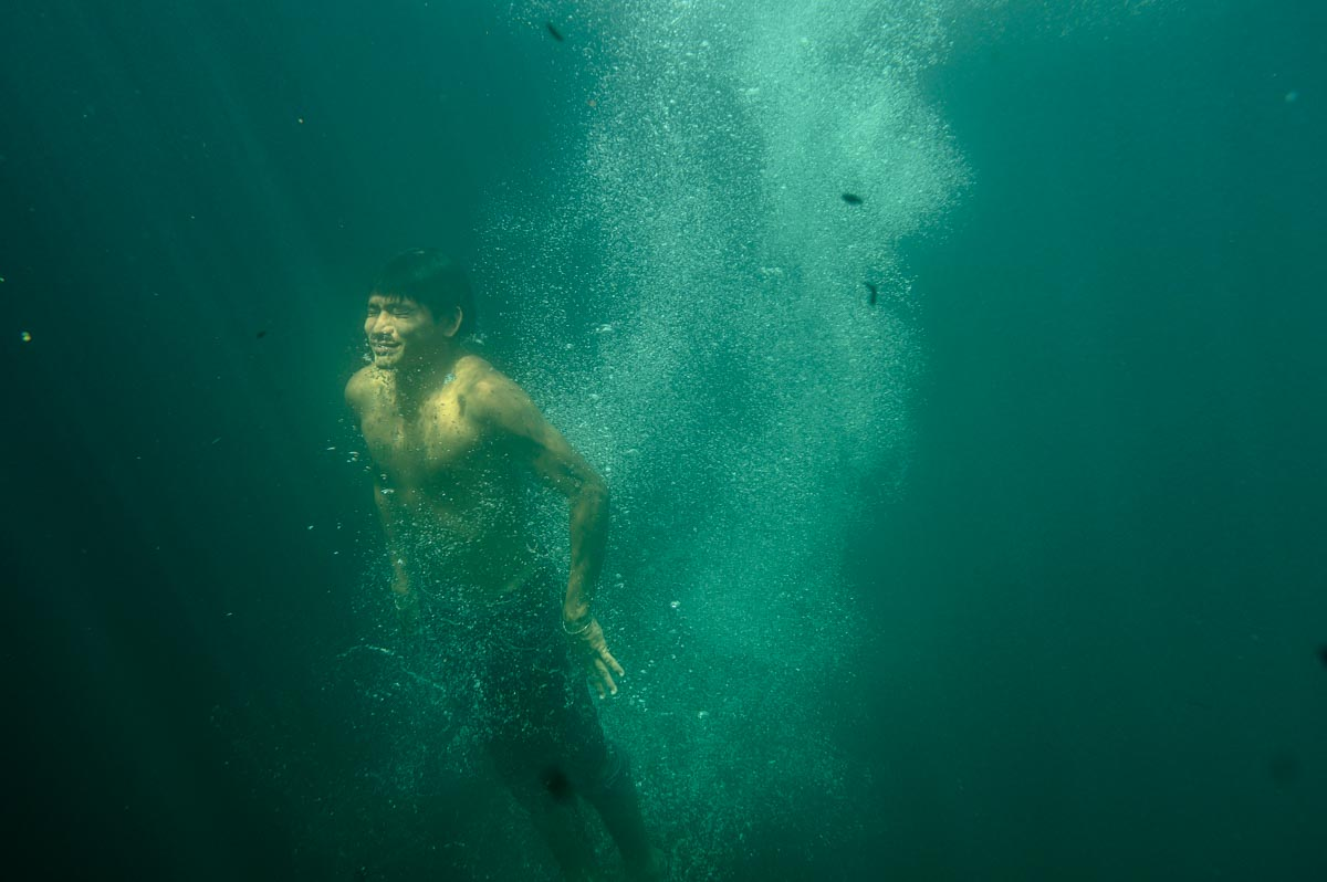 swimmer coming up for air in cenote