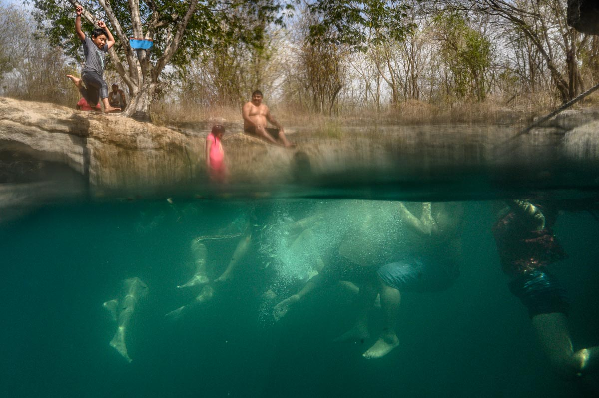 swimmers having fun in cenote