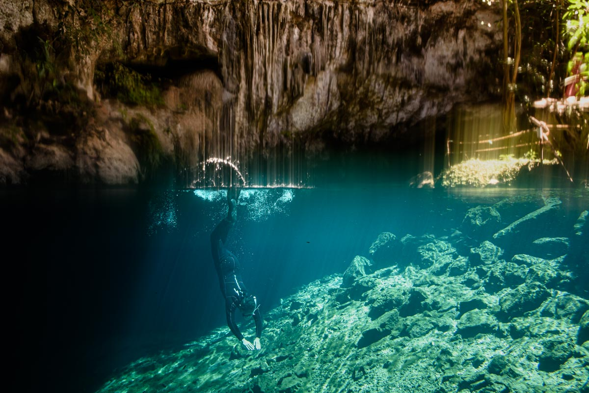 diver diving in cenote